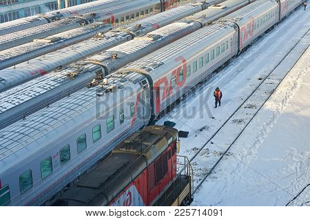 Moscow, Feb. 01, 2018: Russian Railways Passenger Coaches At Rail Way Depot. Maintenance Worker Is S