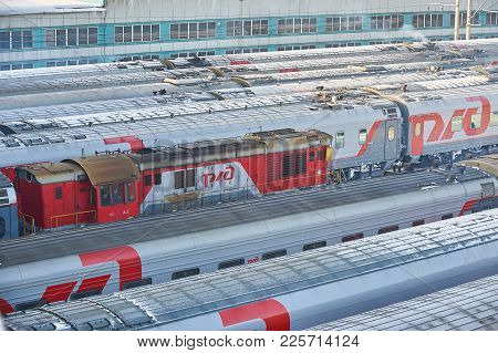 Moscow, Feb. 01, 2018: Winter Top View On Railway Passenger Coaches Cars Locomotive At Rail Way Depo