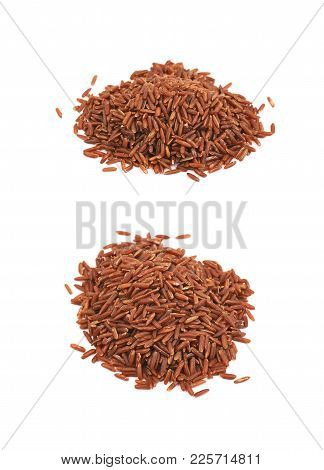 Pile Of Red Rice Isolated Over The White Background , Set Of Several Different Foreshortenings