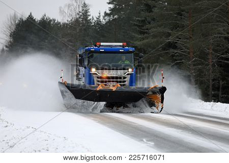 Salo, Finland - February 3, 2018: Scania Truck Equipped With Snowplow Clears A Highway In South Of F