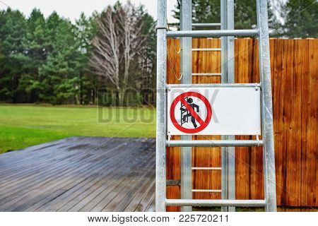 Building And Metal Ladder With Sign Not To Climb The Ladder