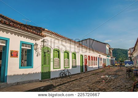 Paraty, Brazil - January 25, 2015. Overview Of Cobblestone Street With Old Houses Under Blue Sunny S