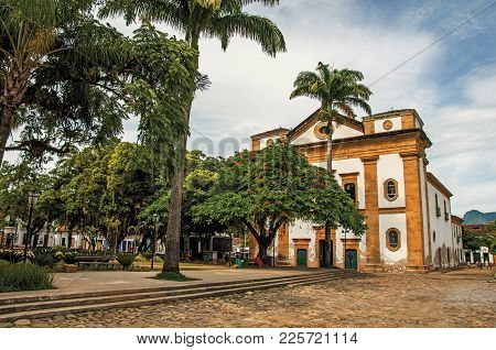 Overview Of Old Colored Church, Garden With Trees And Cobblestone Street In Paraty, An Amazing And H
