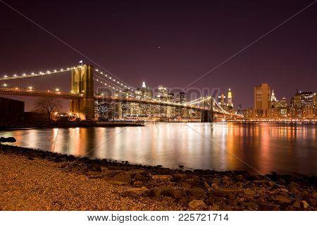 Brooklyn Bridge Over The East River And Downtown Skyline, Manhattan, New York City, New York, United