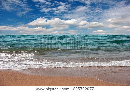 sunny sandy beach on the sea coast