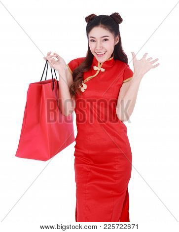 Woman Holding Shopping Bag On Chinese New Year Celebration Isolated On A White Background