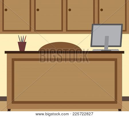 An Office With Desk, Computer And Chair Is Unoccupied