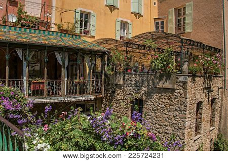 Moustiers-sainte-marie, France - July 08, 2016. Restaurant With Flowers And Stone Walls In The Lovel
