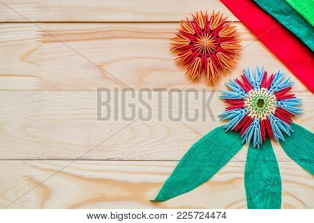 Module Origami Flowers With Crepe Paper On Wooden Background