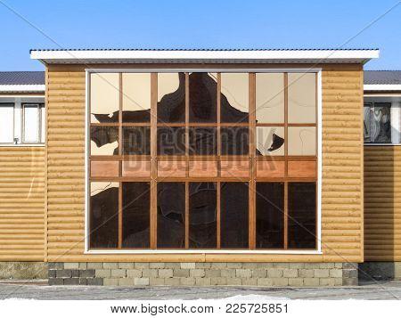 A Modern Building. Finishing Siding. Imitation Of A Tree. Facade