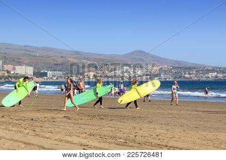 Gran Canaria, Spain - December 1, 2015: Surfers Visit Playa Ingles Beach In Maspalomas, Gran Canaria