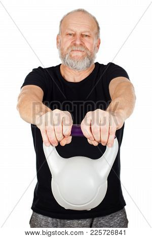 Fit Senior Man Working Out Using Kettlebell On Isolated Background