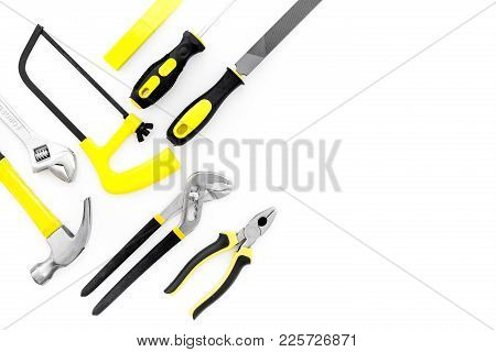 Tools For Repair And Building. File, Saw, Hummer On White Background Top View.