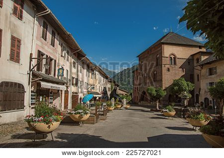 Conflans, France - June 29, 2016. Square With Stone Building And Shops In Conflans. An Historical Ha