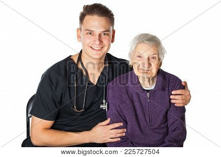 Smiling Elderly Woman With Friendly Male Physician On Isolated Background