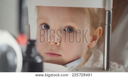 Ophthalmology Clinic For Children - Optometrist Diagnosis Little Blonde Girl, Close Up