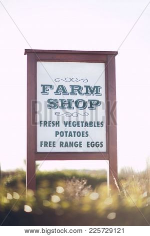 Sign Advertising Products For Sale At A Farm Shop In England