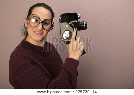 Portrait Of Woman With Big Glasses Holding Old Vintage Film Camera