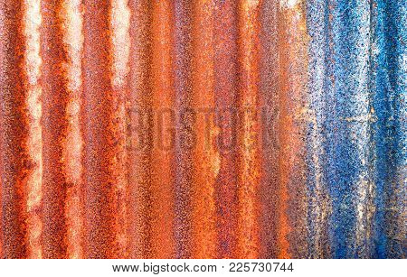 Rusty Corrugated Metal Sheet Background - Old Galvanized Steel Panel Orange  Blue Color With Vertica