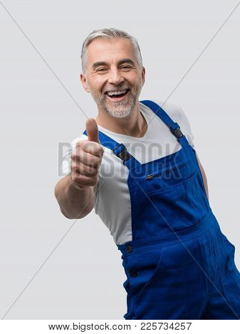Smiling Repairman Giving A Thumbs Up