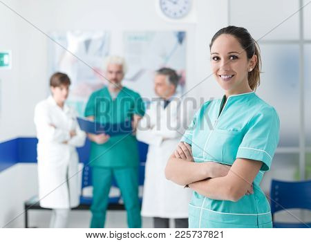 Medical Team Posing At The Hospital And Young Nurse