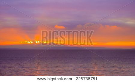 Colorful Sunrise In Golden And Magenta Colors With Sea And Sky Background.