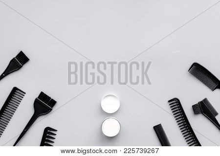 Professional Hairdressing Tools In Beauty Saloon. Combs, Brushes On Grey Background Top View.