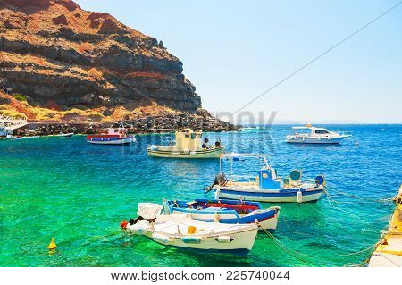 Traditional Greek Boats In The Port Of Santorini Island, Greece. Summer Landscape, Sea View