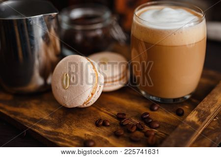 Large Grain Of Coffee, A Glass Of Coffee, And Milk Latte Latte, Two Macaroons. Stand On A Wooden Tra