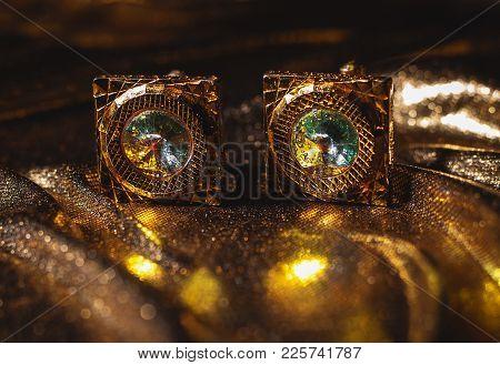 Closeup Of Masculine Accessory - Golden Cufflinks
