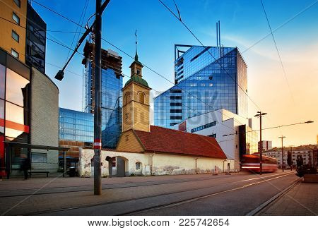 View To Tallinn In Late Evening In Summer. Estonian Capital. City Landscape With Tram On The Road An
