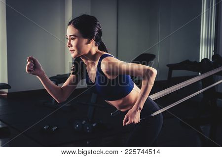 Woman Workingout With Resistance Elastic Band In Gym