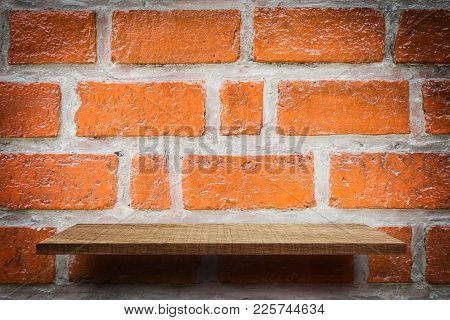 Empty Shelf Product Display On Red Brick Wall Background