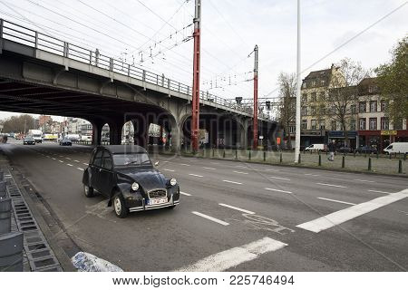 Brussels / Belgium - November 25th 2017: A Old Beetle Car As The Only Car On A Intersection In Bruss