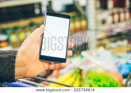 Man Look Into Phone For A Shopping List White Screen For Text