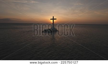 Sunken Cemetery Cross In Camiguin Island, Philippines. Large Crucafix Marking The Underwater Sunken