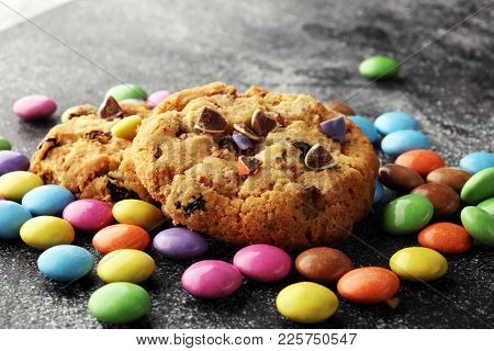 Chocolate cookies with colorful candies. Chocolate chip smarties cookies.