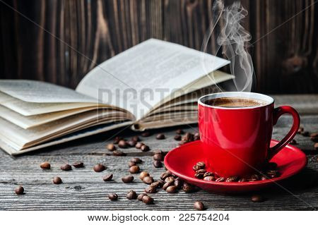 Red Cup Of Coffee And Books Opened Diary On Wooden Table With Coffee Beans