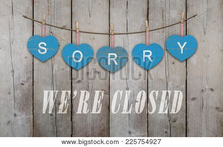 Blue Wooden Hearts With Text Sorry We Are Closed, On Old Scaffolding Wooden Backdrop, With Copy Spac
