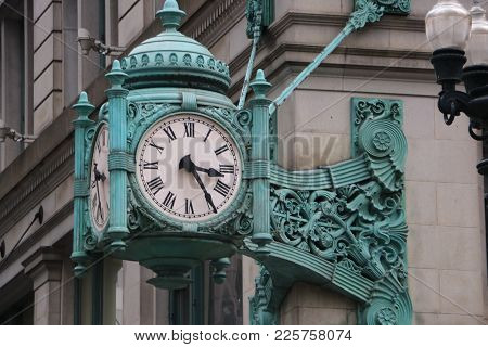 A Clock In Chicago, Il Showing 3:25 Pm