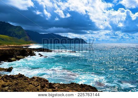 Waves Crashing Onto Volcanic Lava Rocks On The Rural Rugged Hawaiian Coast Taken At Yokohama Beach I