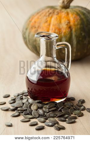 Bottle with tasty pumpkin seed oil and roasted seeds