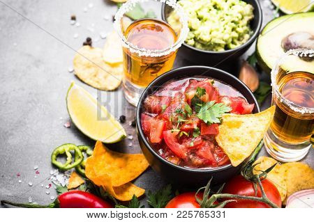 Latinamerican Mexican Food Party Sauce Guacamole, Salsa, Chips And Tequila.