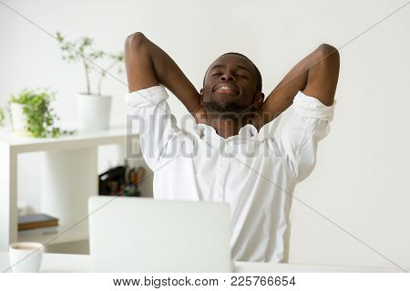 African American Young Businessman Relaxing At Workplace With Laptop, Relaxed Calm Black Employee Fe