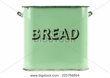 Vintage 1930s green enamel bread bin on a white background poster
