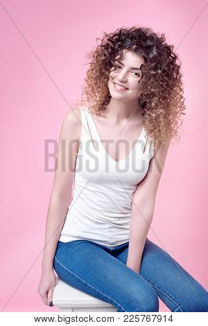 Happy Smiling Young Woman With Amazing Shine Curls Isolated On Background. Beautiful People. Hair St