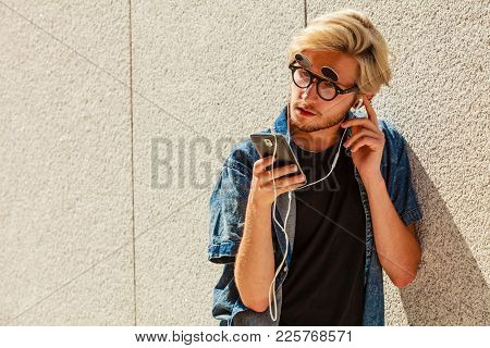 Men Fashion, Technology, Urban Style Clothing Concept. Hipster Guy Standing On City Street Wearing J