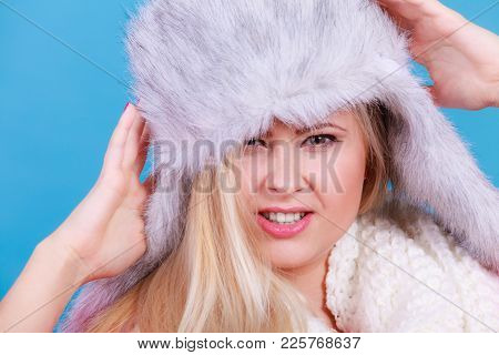 Accessories And Clothes For Cold Days, Fashion Concept. Happy Blonde Woman In Winter Warm Furry Hat