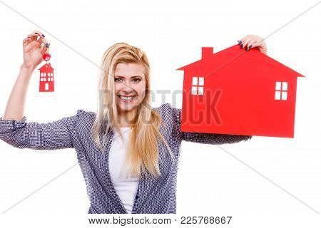 Ownership Property Real Estate Concept. Blonde Woman Holding Red Paper House Symbol And Key. New Fla