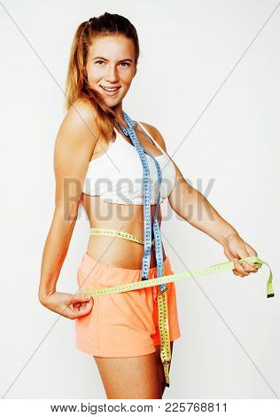 Woman Measuring Waist With Tape On Knot Like A Gift, Tan Isolated Close Up White Background, Diet Pe